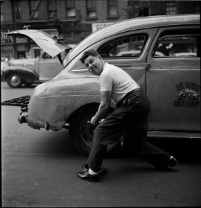 Changing the Tire, Photograph by Stanley Kubrick for Look Magazine